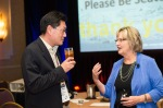 CSL Executive Director Mary Jo Bitner talking to CSL Faculty Network member Seigyoung Auh